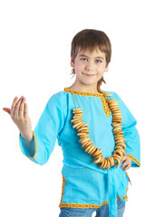 The boy in Russian national shirt c with a bread ring, isolated