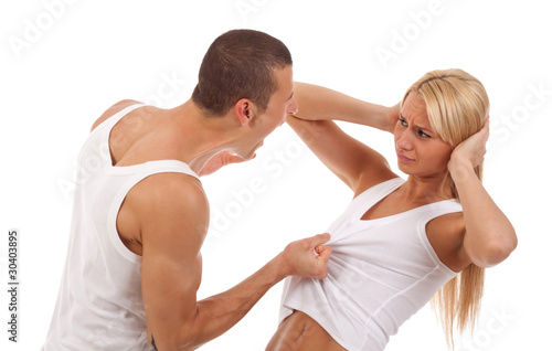man screaming and pulling his girlfriend's shirt