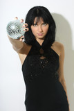 Beautiful woman with discoball in hand poster