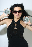 Beautiful woman with discoballs in hands poster