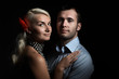 Young couple in love together on dramatic black background