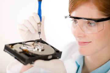 Female computer engineer - woman repair hard disc