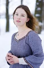 Girl in medieval dress in winter