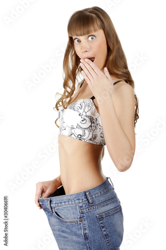 Woman in her old jeans after losing weight