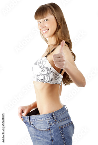 Woman loosing weight and showing a thumb up sign