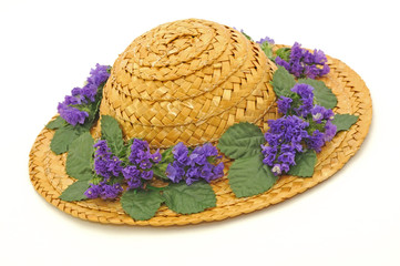 Straw hat with purple flowers