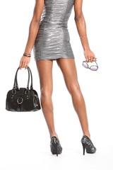 Sexy long legs of fashion model in silver dress