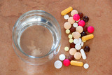 Pills and water glass