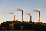 Industrial Smokestacks at Sunset poster