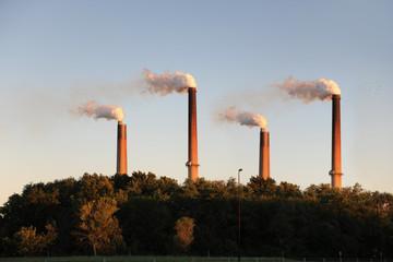 Industrial Smokestacks at Sunset