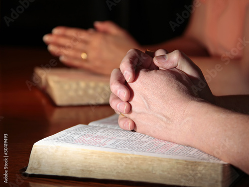 Man and Woman Praying with Holy Bibles - 30419493