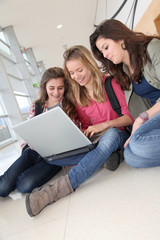 Group of teenage girls at school with laptop computer