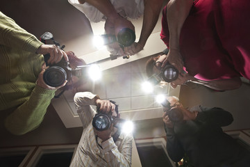 Paparazzi Photographers Shooting a Victim of Crime