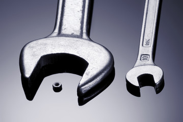 Hand wrench and small metal nut