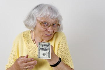 Senior woman offering cash