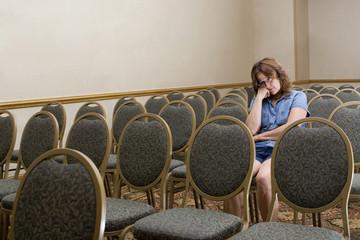 Woman at a boring conference