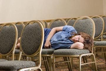 Woman sleeping at a boring conference