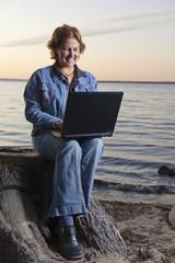 Happy businesswoman teleworking