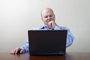 Bored yawning businessman