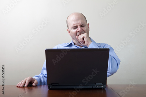 Bored yawning businessman
