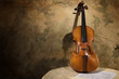 Old italian violin on a wall backround