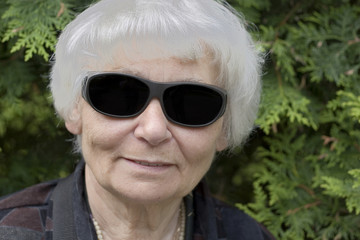 Senior woman dark glasses
