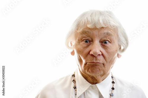 Senior woman studio portrait surprised