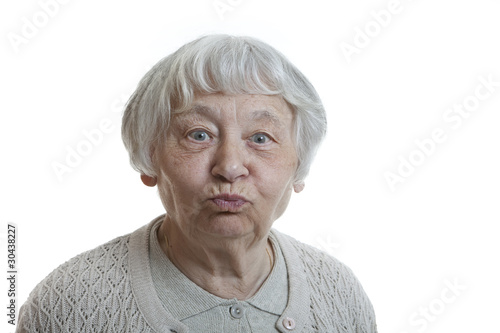 Senior woman studio portrait grimacing