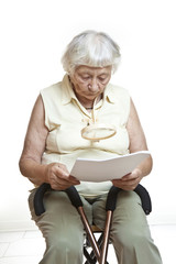Concerned senior reading letter
