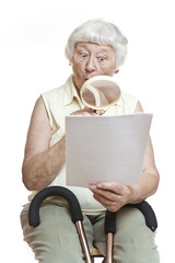 Surprised senior reading letter