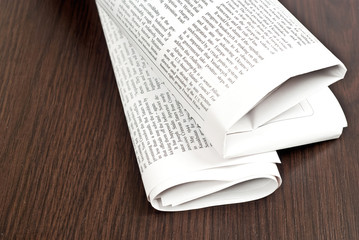 Newspaper on table