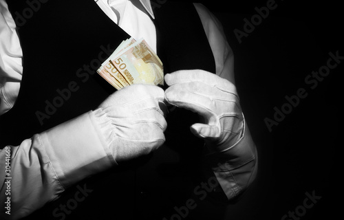 Corruption -butler putting money in his pocket
