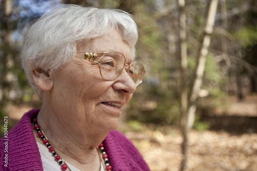 Happy outdoor senior woman portrait