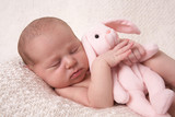 sleeping baby with  pink bunny
