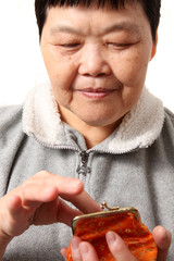 senior chinese woman taking money from bag
