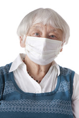 Senior woman with flu mask