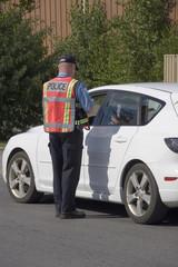Police officer issuing speeding ticket