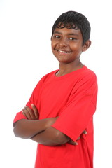 Smiling teenage boy arms folded in studio