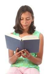Teenage girl reading a blue book