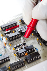 engineer repairing industrial circuit board