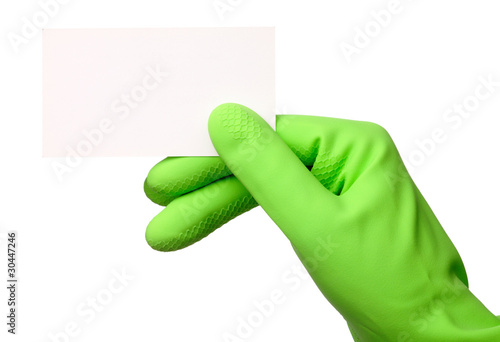 Hand in green glove showing business card