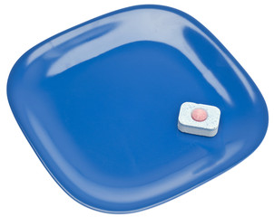 Dishwashing Tablet and Clean Plate