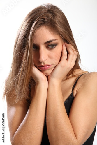 Not interested says young woman with hands over ears