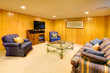 Basement family room with blue sofas