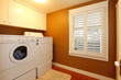Laundry room with gold colors