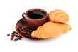 Croissants, cup of coffee and beans isolated on white
