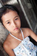 Young Asian girl against wall - Philippine poverty