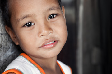 Young impoverished Asian boy portrait in Philippines
