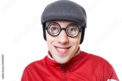 Portrait of a young nerd in funny glasses isolated on white