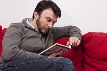 Portrait of Young Adult Relaxing and Reading a Book at Home
